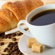 Breakfast with coffee and croissant - Stockfoto
