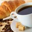 Breakfast with coffee and croissant - Stok fotoğraf