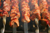 Kebab on the grill with smoke — Stock Photo