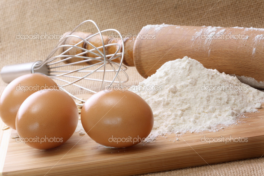 Ingredients to bake with Rolling Pin and Whisk — Stock Photo #2630998