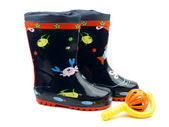 Blue Galoshes With a toy — Stock Photo