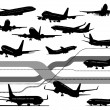 Stock Vector: 13 black and white Airplane silhouettes.
