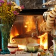 Stock Photo: Tedrinking at fireplace