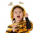 Stock Photo: Little girl with honey glas