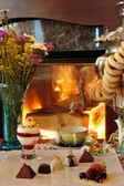 Tea drinking at a fireplace — Stock Photo