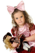 The little girl with doll — Stock Photo