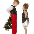 Children with a Christmas tree — Stock Photo