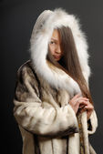 The girl in a fur coat — Stock Photo