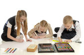 Children engaged in drawing — Stock Photo