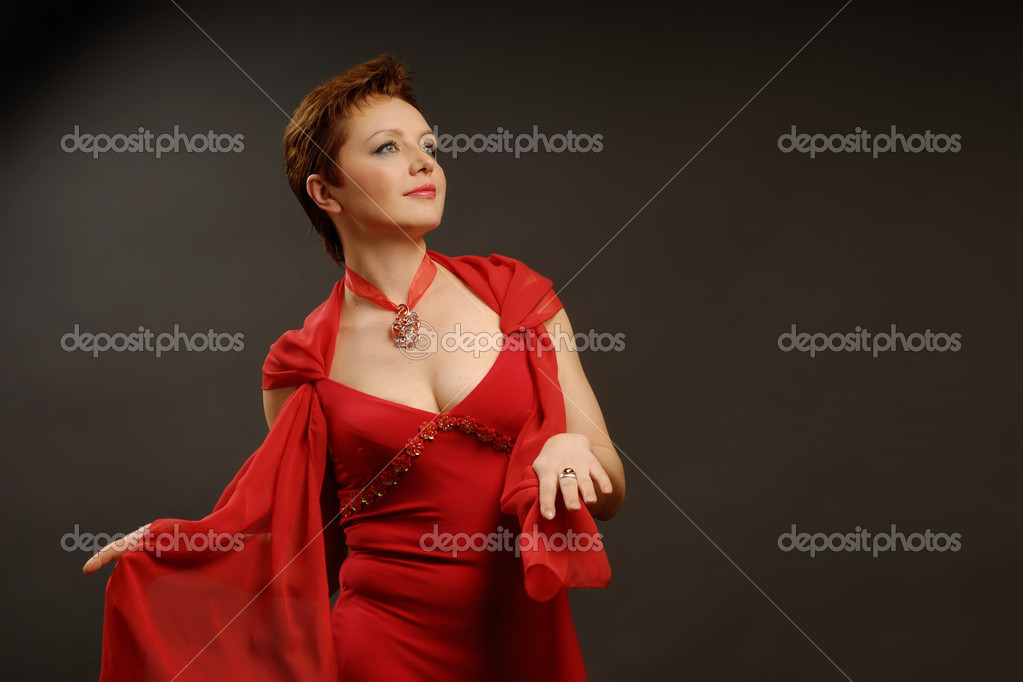 Lady in red on a dark background — Stock Photo #1855496