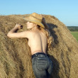 Girl on fresh hay - Stock Photo
