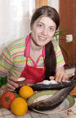 Girl is salting a herring — Stock Photo
