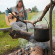 Royalty-Free Stock Photo: Cooking fresh food in cauldron at camp o