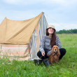 Girl with dog at camping — Stock Photo