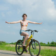 Royalty-Free Stock Photo: Girl goes on bicycle