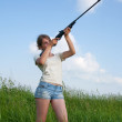 Aiming girl — Stock Photo