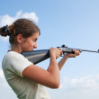 Girl with air rifle — Stock Photo