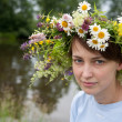 Girl  in camomile chaplet — Stock Photo