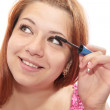 Girl puts mascara on — Stock Photo