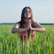 Young woman doing yoga in green meadow — Stock Photo #1158840
