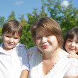 Mother with children on meadow — Stock Photo #1161583