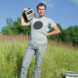 Man with old radio receiver — Stock Photo