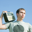 Stock Photo: Man with old radio receiver