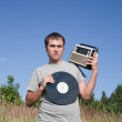 Stock Photo: Man with vinyl disk and radio receiver