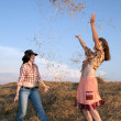 Playing girls in hay — Stock Photo