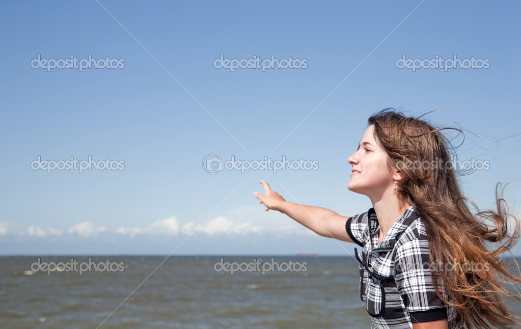 Girl on mooring against sea and sky  Stock Photo #1181559