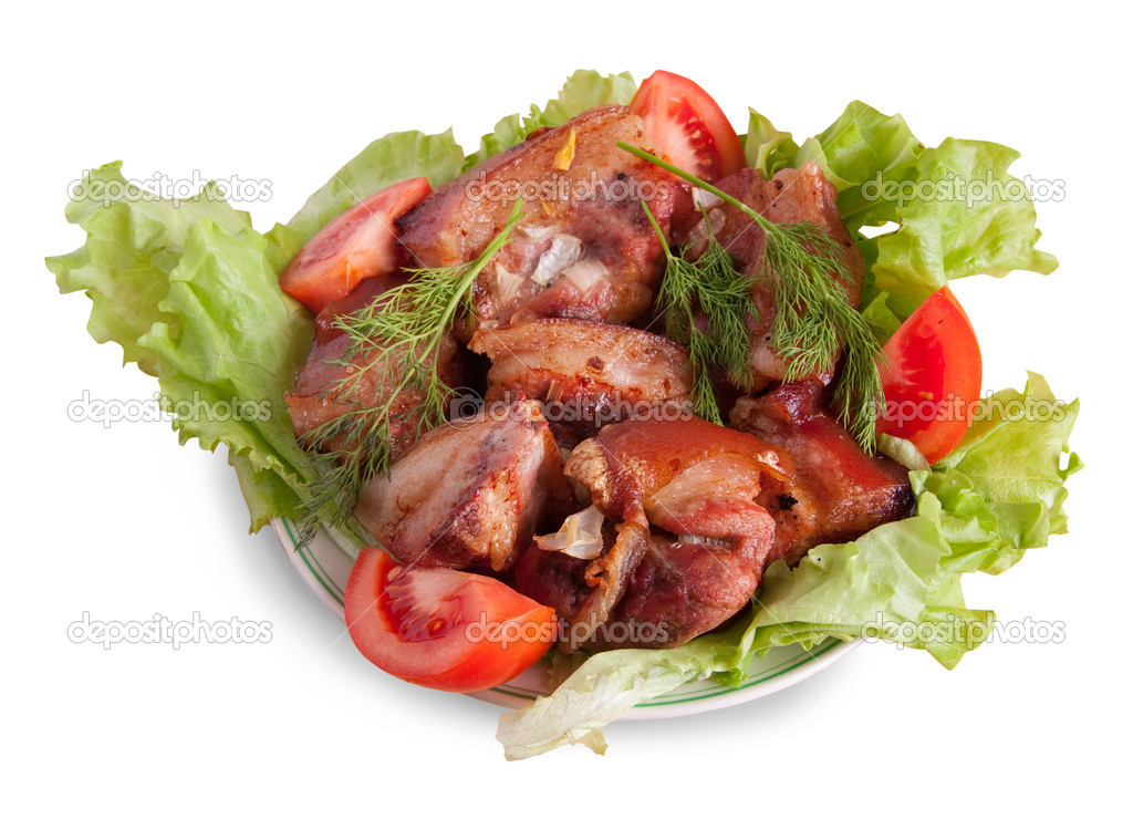 Stewed meat meat and tomatoes on Green leave — Stock Photo #1183328