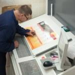 Printer checking a print run — Stock Photo #1191642