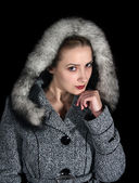Portrait of woman in gray coat — Stock Photo