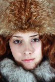 Portrait of girl in fox cap — Stock Photo