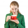 Girl drinks tea from a red cup — Stock Photo #1723110
