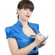 Stock Photo: Female manager writing on a notebook