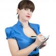 vrouwelijke manager schrijven op een notitieblok — Stockfoto