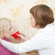 Royalty-Free Stock Photo: Nurse  gives a cup to sick girl