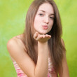 Air-kissing long-haired teen girl — Stock Photo #2107783
