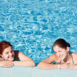 Two happy girls in swimming pool — Stock Photo