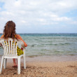 Royalty-Free Stock Photo: Relaxing in chair at sea coast