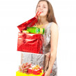 Royalty-Free Stock Photo: Girl with coloured shopping present bags