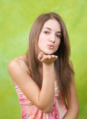 Air-kissing long-haired teen girl — Stock Photo