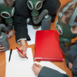 Businessmans in a gas mask — Stock Photo
