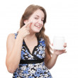 Young girl putting cream - Stockfoto