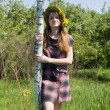 Stock Photo: Girl near birch