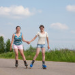 Stock Photo: Two Young girls on roller blades