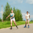 Two Young girls on roller blades — Stock Photo