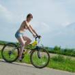 Girl goes on bicycle — Stock Photo