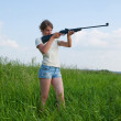 Girl with air rifle — Stock Photo #2114754